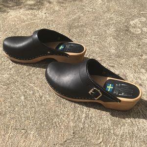 MIA black leather clogs